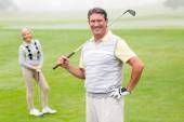 Happy golfer teeing off — Stock Photo