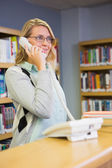 Pretty librarian answering the phone — Stock Photo