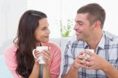 Couple looking at each other while having coffee — Stock Photo