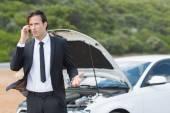 Businessman after car breakdown — Stock Photo