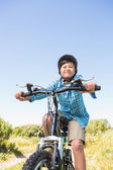 Little boy biking through mountains — Zdjęcie stockowe