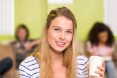 Casual young woman holding disposable cup — Stock Photo