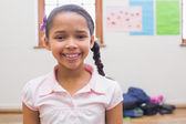 Smiling pupil in classroom — Stock Photo