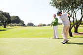 Golfing friends teeing off  — Stock Photo
