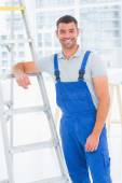 Happy handyman in overalls — Stock Photo