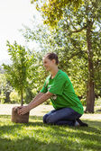 Environmental activist about to plant tree — Stock Photo