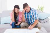 Worried couple calculating home finances — Stock Photo