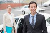 Team of businessman smiling at camera — Stock Photo