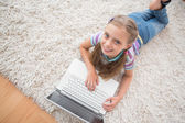 Cute girl using laptop — Stock Photo