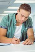 Student taking notes in class — Stock Photo