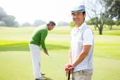 Golfing friends on the putting green  — Stock Photo