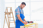 Handyman working at workbench in office — Stock Photo