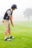 Concentrate golfer lining up his shot — Stock Photo