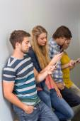 College students using cellphones — Stock Photo