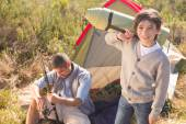 Father and son beside their tent — Stock Photo