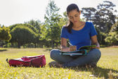 Pretty student studying outside — Stock Photo