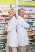 Pharmacist with his colleague standing with arms crossed — Stock Photo