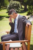 Businessman thinking in the park — Stock Photo