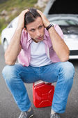 Stressed man after car breakdown — Stock Photo