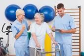 Therapists with invalid senior woman  — Stock Photo