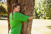 Environmental activist hugging a tree — Stock Photo