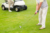 Golfer about to tee off — Stock Photo