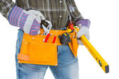 Handyman holding spirit level — Stock Photo