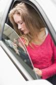 Young woman holding seat belt — Stock Photo