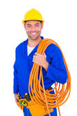 Smiling handyman with rolled wire — Stock Photo