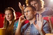 Annoying man on the phone during movie — Stock Photo