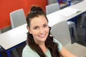 Portrait of smiling female student in classroom — Stock Photo