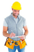 Repairman writing on clipboard — Stock Photo