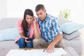 Couple calculating home finances at table — Stock Photo