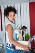 Woman carrying her belongings in box — Stock Photo