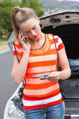 Young woman calling with her mobile phone — Stock Photo
