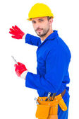 Handyman holding spanner — Stock Photo