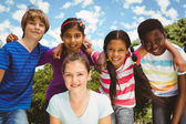 Happy children forming huddle at park — Stock Photo