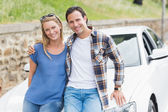 Couple leaning on the bonnet — Stock Photo