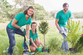 Young woman gardening for the community — Stockfoto