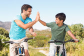 Father and son on a bike ride — Stock Photo