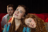 Young friends watching a film — Stock fotografie