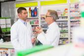 Team of pharmacist speaking together — Stock Photo