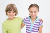 Cute siblings standing arm around — Stock Photo