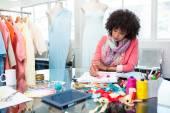 Female fashion designer sketching — Stock Photo