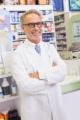 Senior pharmacist with arms crossed — Stock Photo