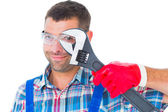 Repairman looking through adjustable wrench — Stock Photo