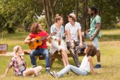 Happy friends in the park — Stock Photo