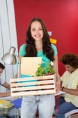 Casual businesswoman carrying her belongings in box — Stock Photo