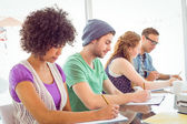 Fashion students writing on notepad  — Stock Photo