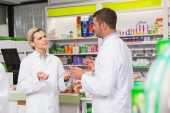 Team of pharmacist talking together — Stock Photo